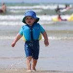 boy walking in sea 150x150