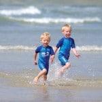 boys running on beach 150x150
