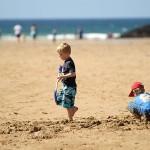 children digging on beach 150x150