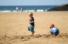 children-digging-on-beach