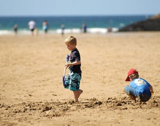 children-digging-on-beach