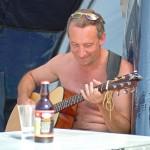man playing guitar at porth beach 150x150