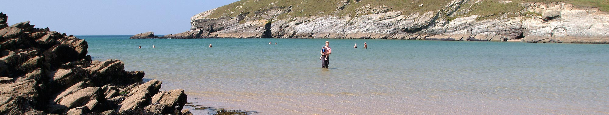 Paddling in the sea at Porth